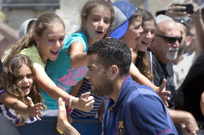 Barcelona's football player, defender Daniel Alves, is greeted by Israeli fans during a visit by the football team to the Western Wall in the Jerusalem's old city on Sunday, Aug 4, 2013.Israeli President Shimon Peres on Sunday praised Lionel Me