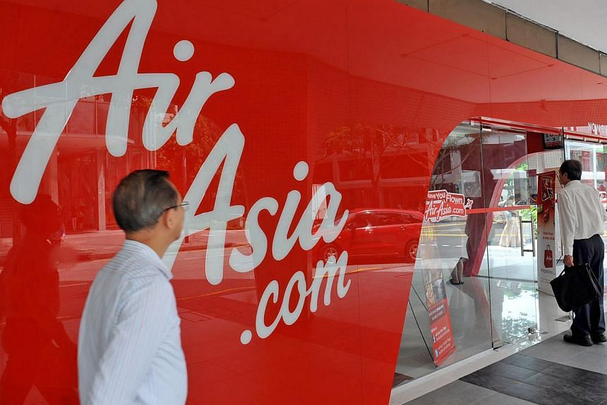 Budget airline AirAsia's sales office located at Peninsula Plaza building along North Bridge Road, on Aug 25, 2010. AirAsia has warned the public of a lottery scam circulating online. -- ST FILE PHOTO: JOYCE FANG