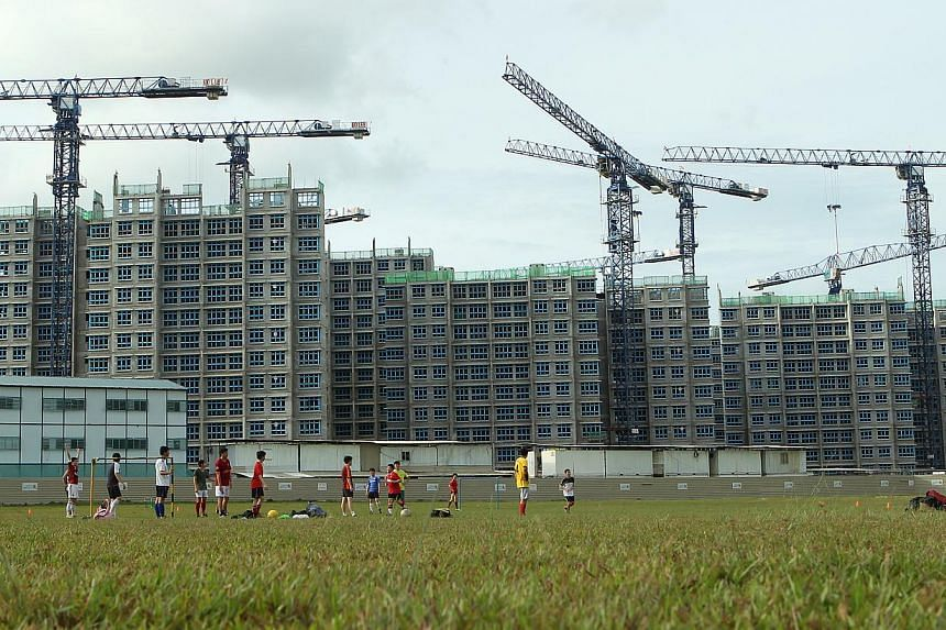 Build-To-Order (BTO) flats at Sengkang Central under construction. Demand from singles for Sengkang flats continued strong on Monday - the last day for applications for the Build-To-Order application exercise. -- ST FILE PHOTO: SEAH KWANG PENG