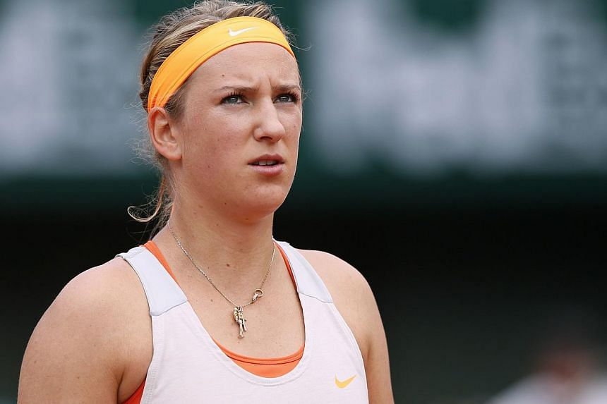 Belarus' Victoria Azarenka looks on after a point against Russia's Maria Sharapova during a French tennis Open semi final match at the Roland Garros stadium in Paris on June 6, 2013. Two-time Australian Open winner Victoria Azarenka withdrew on