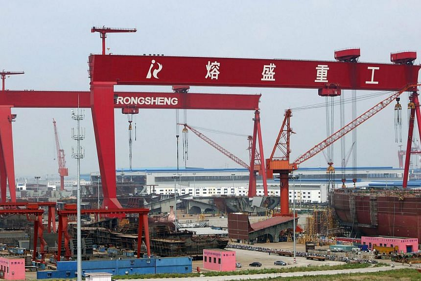 A view of the Rongsheng Heavy Industries shipyard is seen in Nantong, Jiangsu province in this May 21, 2012 file photo.China has laid out a detailed three-year plan to restructure its massive shipbuilding industry, urging local governments to h