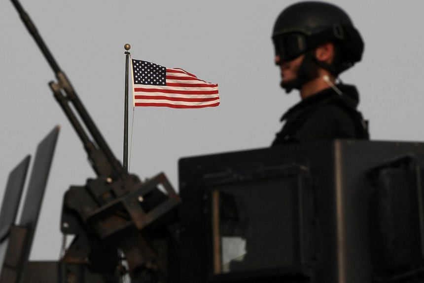 A Bahraini armored personnel vehicle reinforces U.S. Embassy security just outside a gate to the embassy building in Manama, Bahrain, on Sunday, Aug. 4, 2013. The United States said on Sunday that 19 of its embassies and consulates in the Mideast and