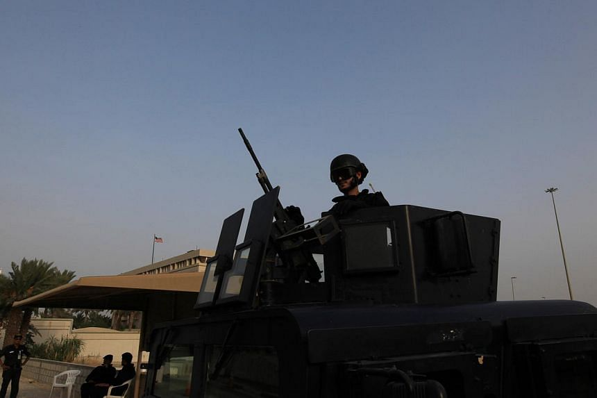 A Bahraini armored personnel vehicle and security forces reinforce U.S. Embassy security just outside a gate to the embassy building in Manama, Bahrain, on Sunday, Aug. 4, 2013. The United States said on Sunday that 19 of its embassies and