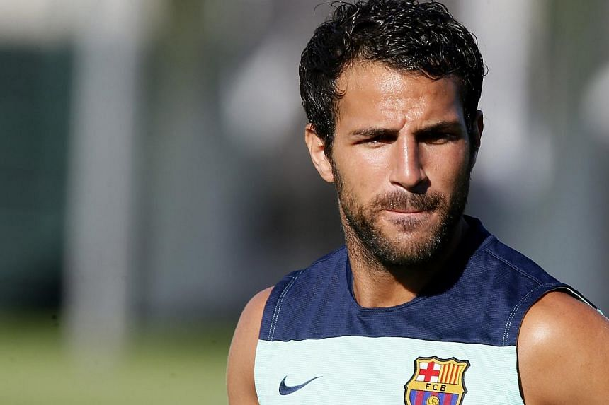 Barcelona's Cesc Fabregas reacts during a training session at Ciutat Esportiva Joan Gamper in Sant Joan Despi, near Barcelona, on July 29, 2013. Barcelona sporting director Andoni Zubizarreta has claimed that Manchester United have abandoned their in