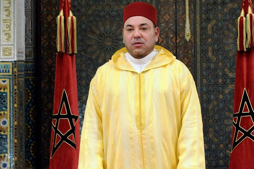 Handout photo released by Moroccan Press Agency shows King Mohammed VI of Morocco delivers a speech on July 30, 2013 in Casablanca marking his 14 years anniveresary on the throne, in Casablanca, Morocco. King Mohamed VI of Morocco on Sunday revoked a