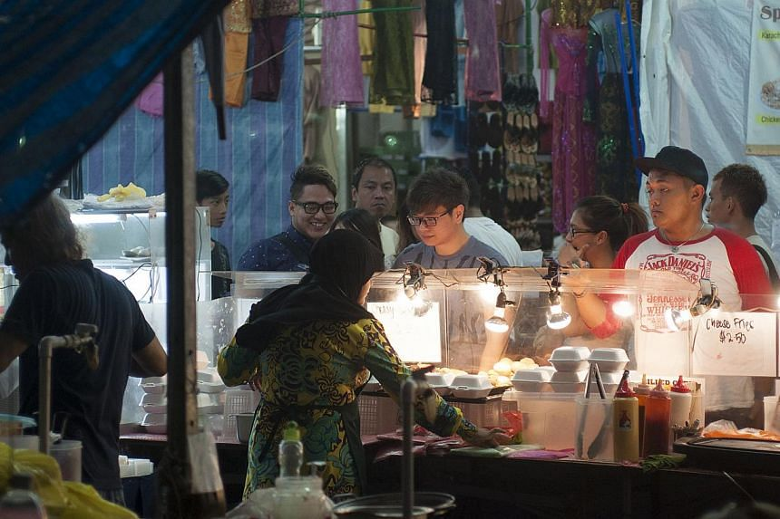 Some stallholders said crowds are about half that of last year, but traffic picked up over the weekend, the last before the festival.