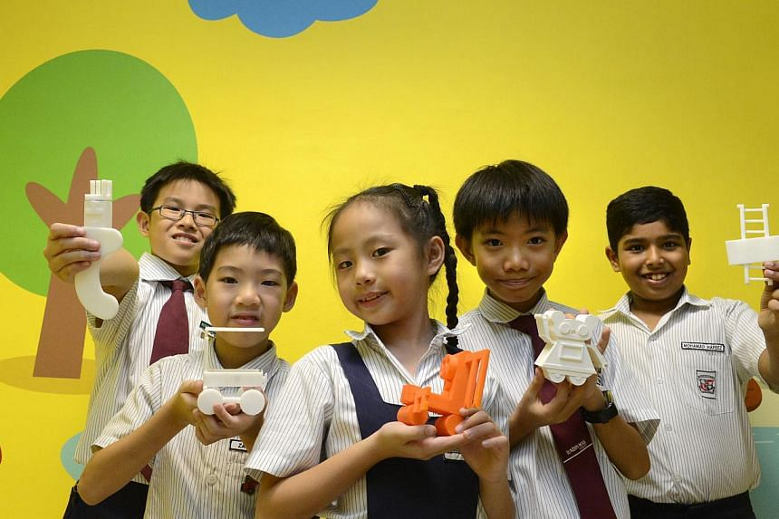 (From left) Radin Mas Primary School pupils Keison Tan, Zachary Wah, Thea Huan, Tan Rui Yang and Mohamad Hafeez with their models from a 3-D printing workshop. Schools are introducing cutting-edge technology to equip pupils with 21st century skills.