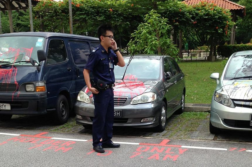 Two cars and a van in a carpark near Block 651, Hougang Avenue 8, were splashed with paint. Residents said loan sharks had been targeting a flat there for the past three months, although the debtor did not live there. -- PHOTO: ST READER
