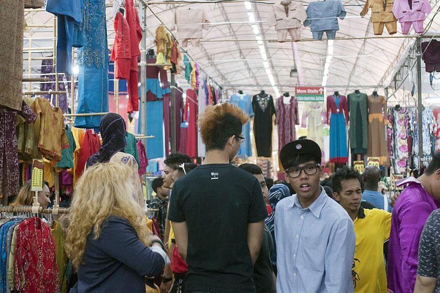 A crowded walkway in the Geylang Serai bazaar. -- ST PHOTO: CHERYL FAITH WEE