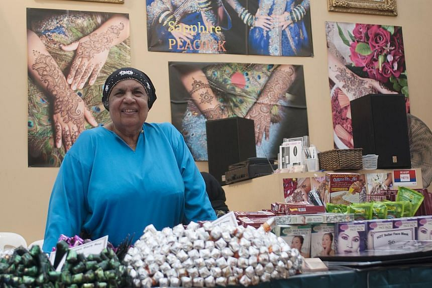 Ms Janet Mastan, 77, and her family have been running stalls at the Geylang Serai bazaar for the past 26 years. -- ST PHOTO: CHERYL FAITH WEE