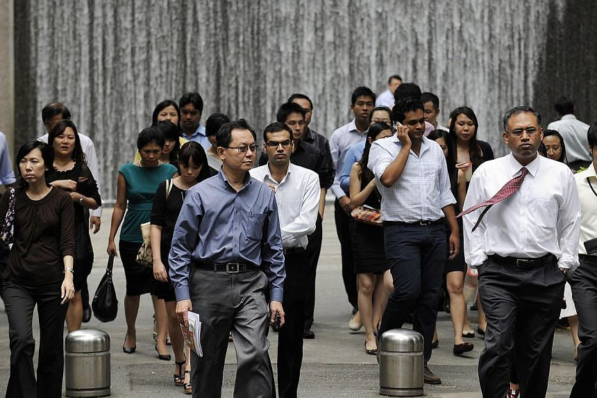 Companies should try to draw more older workers and women back to the labour force, said Acting Manpower Minister Tan Chuan-Jin on Monday, Aug 5, 2013. -- FILE PHOTO: BLOOMBERG