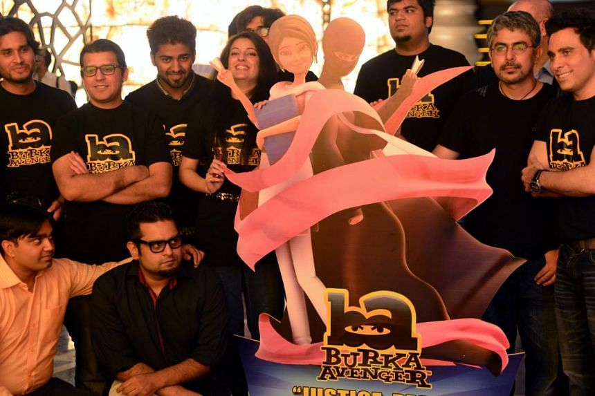 Haroon Rashid, one of Pakistan's biggest pop star (right) poses with his team at the press presentation of cartoon show Burka Avenger in Rawalpindi on Aug 4, 2013. Pakistan's new cartoon superhero who fights bad guys disguised in a flowing black burk