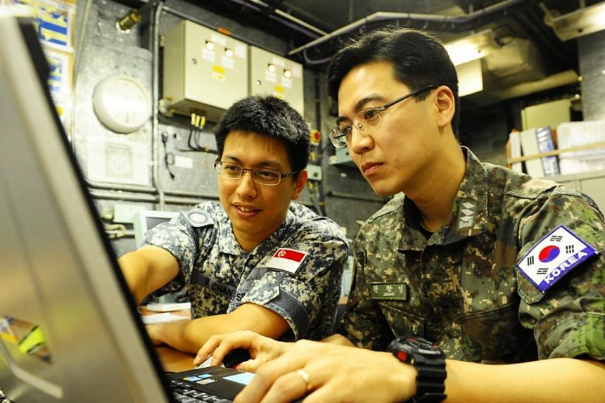A member of the SAF Command Team working with his South Korean counterpart during their deployment to the Gulf of Aden. For three months, members of the Combined Task Force (CTF) 151 remained alert and thwarted numerous piracy attempts in the Gulf of
