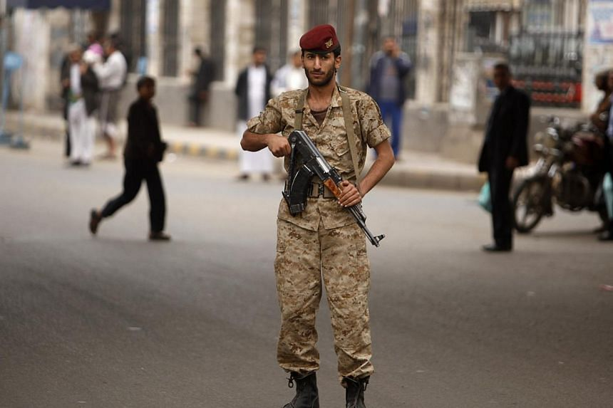 An army trooper mans a checkpoint in Sanaa on Monday, Aug 5, 2013. Britain and France extended the closure of their embassies in Yemen on Monday after a US warning of a possible militant attack in the region, and the Arab state said it was stepping u