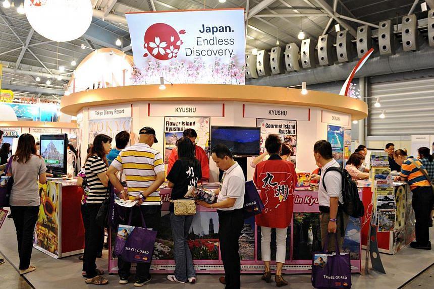People at the Japan booth the at Natas Travel Fair 2013 held at the Singapore Expo on Feb 22, 2013. -- ST FILE PHOTO:MUGILAN RAJASEGERAN