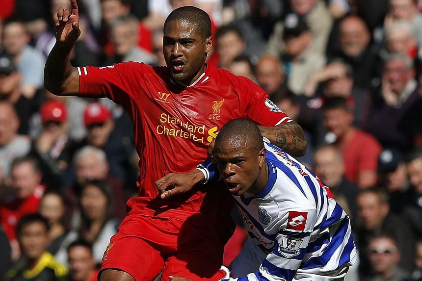 Liverpool's Glen Johnson (left) challenges Queens Park Rangers' Loic Remy during their English Premier League occer match at Anfield in Liverpool, northern England on May 19, 2013. Newcastle finally made their first significant signing since the
