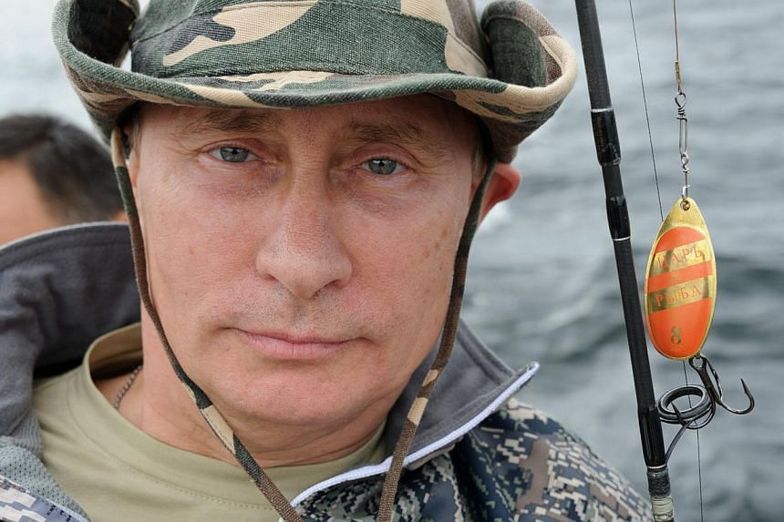 Russian President Vladimir fishes during a mini-break in the Siberian Tyva region, Russia on Saturday, July 20, 2013.The secrets of Russian President Vladimir Putin's buff physique and youthful appearance are the result of herbal health remedie
