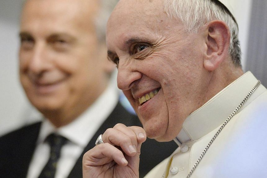 Pope Francis listens to journalists' questions as he flies back Rome following his visit to Brazil on July 29, 2013.Pope Francis, a card-carrying fan of the San Lorenzo soccer club in his native Buenos Aires, is not letting his new global respo