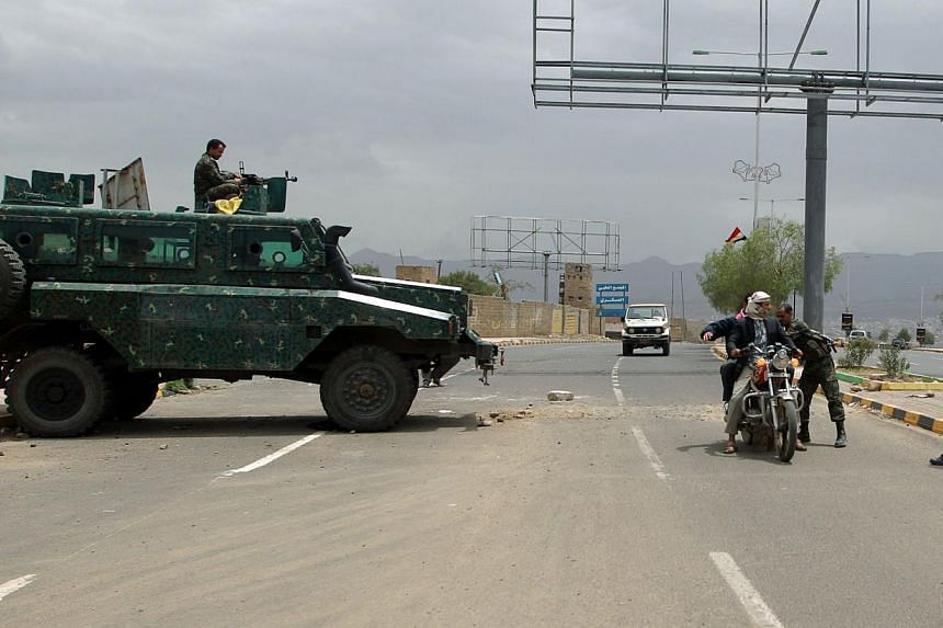 Yemeni soldiers search a motorbike at a checkpoint on a street leading to the US embassy compound in Sanaa on Aug 4, 2013.US missions across the Middle East and Africa will be closed until at least Saturday for fear that Al-Qaeda will launch an