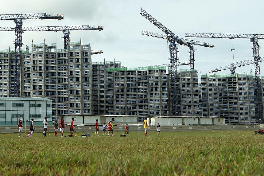 Build-To-Order (BTO) flats under construction in Sengkang. About 58 singles applied for each two-room flat available to them in the BTO launch, according to the Housing Board's final tally. -- ST FILE PHOTO: SEAH KWANG PENG