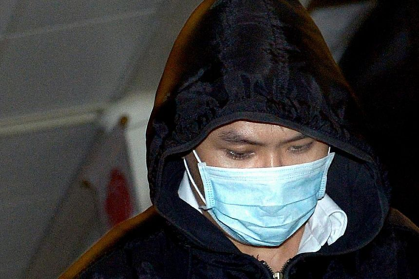 Kew Guozhi (above), 31, who faced a total of 423 counts, pleaded guilty to 11 charges of intruding into the privacy of the women by using a camera pen to capture video recordings of their inner thighs and underwear. -- ST PHOTO: LIM SIN THAI