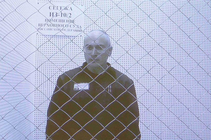 Jailed oil tycoon Mikhail Khodorkovsky is seen on a screen during an appeal for a reduced sentence at Russia's Supreme Court in Moscow on Tuesday, Aug 6, 2013. Khodorkovsky has asked Russia's Supreme Court to release him and overturn a sentence he sa