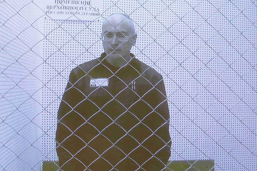 Jailed oil tycoon Mikhail Khodorkovsky is seen on a screen during an appeal for a reduced sentence at Russia's Supreme Court in Moscow on Tuesday, Aug 6, 2013. Khodorkovsky's jail sentence by two months on Tuesday, paving the way for his release in A