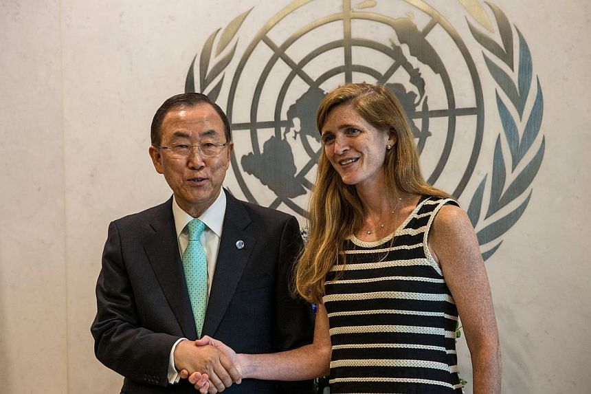 Samantha Power (right), United States Ambassador to the United Nations (UN), meets with UN Secretary General Ban Ki Moon at the UN on Aug 5, 2013 in New York City. Samantha Power presented her credentials to UN Secretary General Ban Ki Moon following