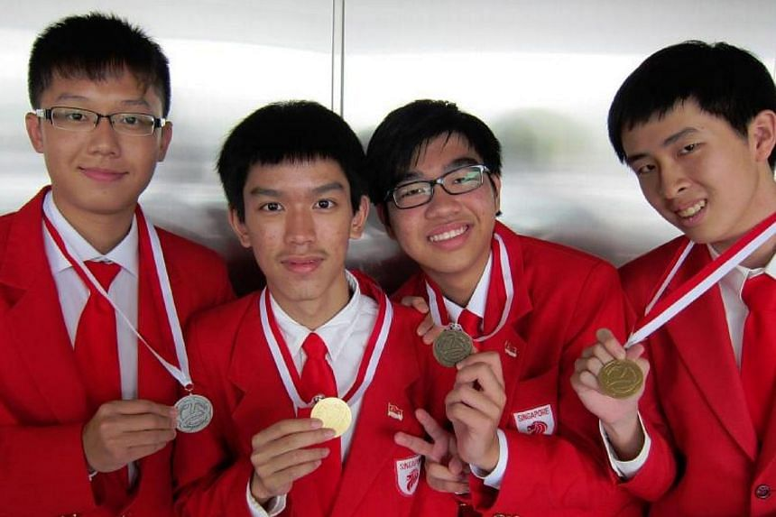 (From left to right): Tan Hean Shuen, Ian Teo Tze-Rong, Eric Ryan Toh Yung Slung, and Daniel Wong Xue Wei. The team from Singapore has placed third in a field of 126 students at the 10th International Geography Olympiad (iGeo) in Japan. -- PHOTO: MIN
