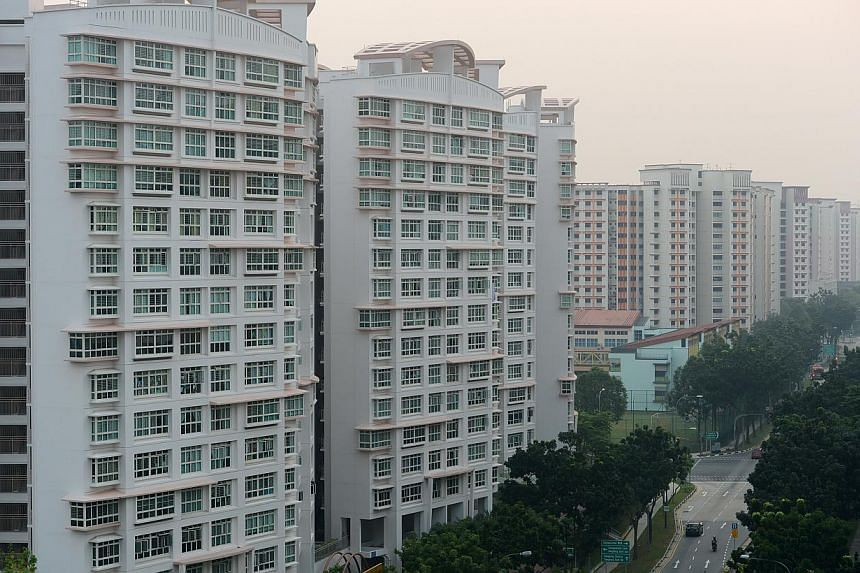 HDB flats along Compassvale Drive appear in this photo taken on June 18, 2013. Overall Housing Board cash-over-valuation (COV) continued a steady decline in July to $20,000, its lowest point since January 2011. -- ST FILE PHOTO: JOYCE FANG