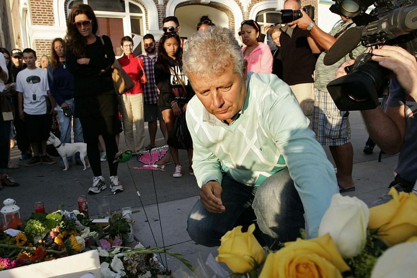 Mr Piero Casadei (centre) and Ms Katia Gruppioni (left, in black), respective father and aunt of newlyweds Christian Casadei and Alice Gruppioni, visit a makeshift memorial at the site where Alice was killed and Christian injured, on the Venice Beach