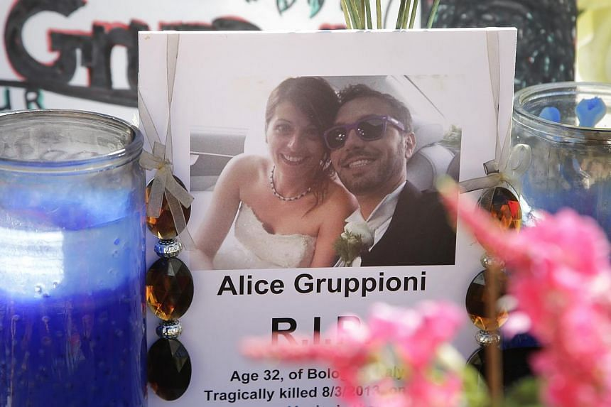 A card showing the photo of Italian newlywed Alice Gruppioni, left, and her husband Christian Casadei, is placed on a makeshift memorial for Gruppioni along Ocean Front Walk at Venice Beach on Monday, Aug 5, 2013, in Los Angeles. -- PHOTO: AP