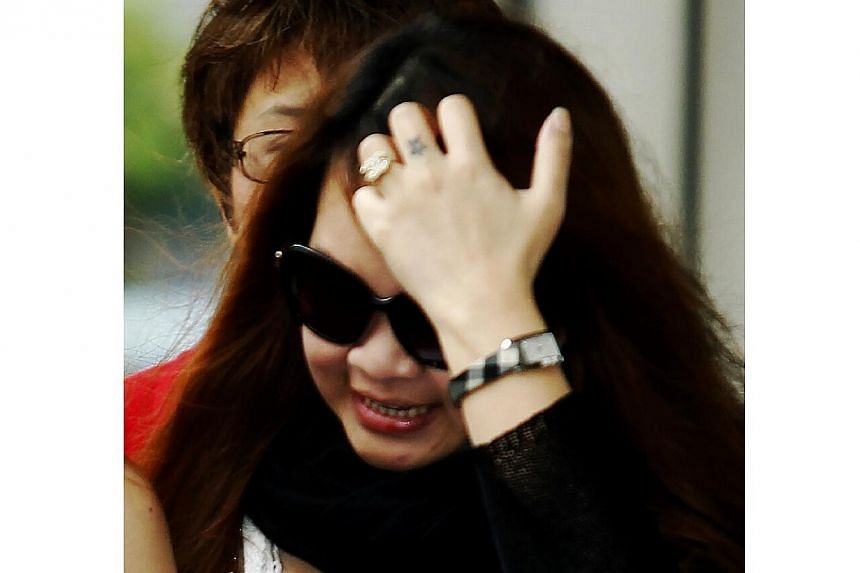 "Chan Huey Fern, who was convicted of five charges of abusing her Indonesian maid in one of the ""most distressing'' domestic maid abuse cases in Singapore, was sentenced to 21 months' jail on Wednesday. -- ST PHOTO: WONG KWAI CHOW"