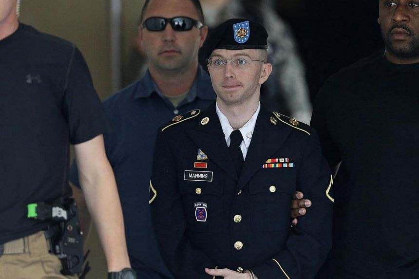 Bradley Manning escorted out of a courthouse in Fort Meade, Maryland on Tuesday, July 30, 2013, after receiving a verdict in his court martial. A US military judge has reduced the maximum sentence Manning could face from 136 to 90 years in prison, th