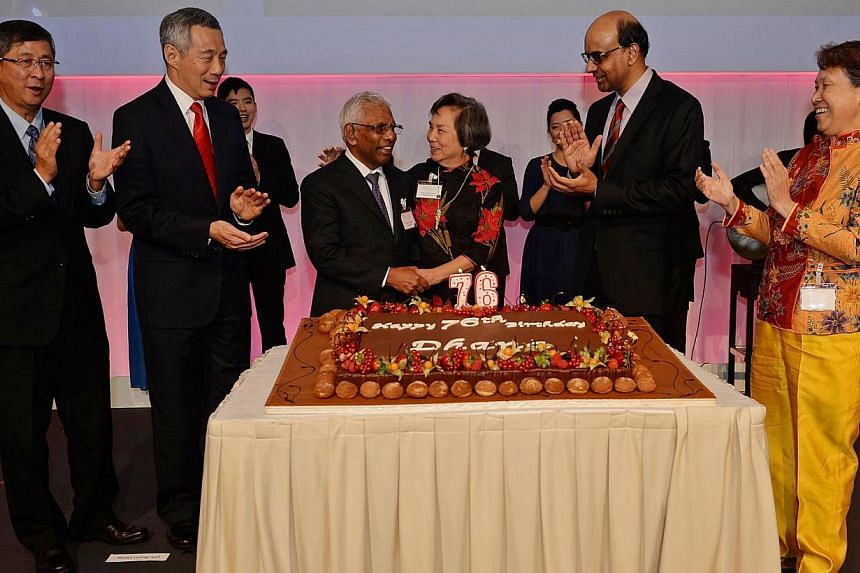 (From left): Temasek chairman Lim Boon Heng, PM Lee Hsien Loong, Mr Dhanabalan and wife Christine, DPM Tharman Shanmugaratnam and Temasek CEO Ho Ching celebrating Mr Dhanabalan's birthday in advance during Temasek's 39th anniversary dinner yesterday.