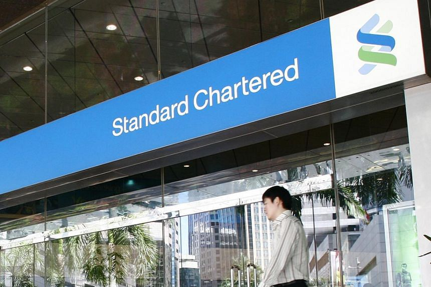 A day after Standard Chartered reported a decline in the group's first-half earnings, the Britain-based lender said its Singapore unit is chugging along. -- ST FILE PHOTO: MARK CHEONG