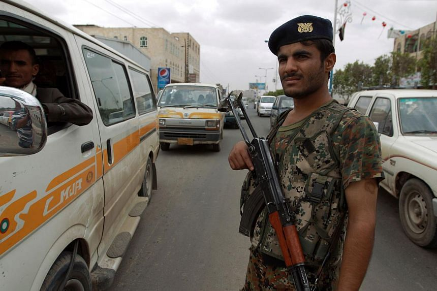 A Yemeni soldier stand guard as vehicles drive near Sanaa International Airport on August 6, 2013 in Yemen. Yemeni security forces have foiled a plot by Al-Qaeda to take over oil and gas export facilities and a provincial capital in the eastern part