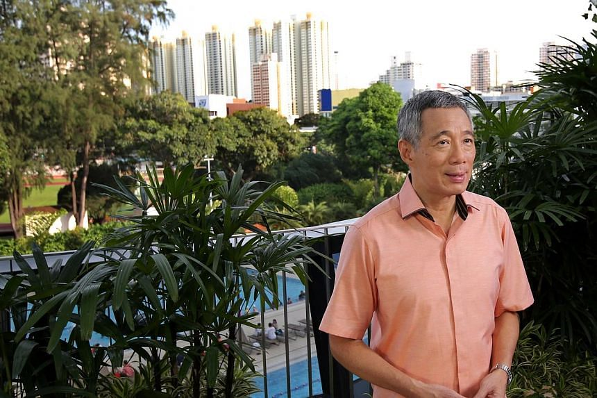 Prime Minister Lee Hsien Loong records his National Day message at Safra Toa Payoh on Aug 3, 2013. The Singapore economy is holding steady and is likely to grow a faster than expected 2.5 per cent to 3.5 per cent this year, said Mr Lee. -- FILE
