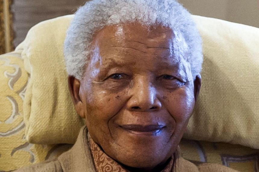 Former South African President Nelson Mandela is pictured during a visit by former US president on July 17, 2012 at his home in Qunu, Eastern Cape, on the eve of his 94th birthday.South African church leaders on Wednesday led prayers in front o