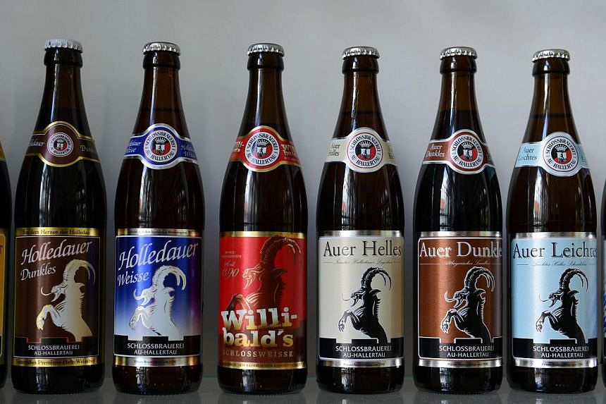 Beer bottles are seen at the brewhouse of the brewery Schlossbrauerei Au-Hallertau in Au-Hallertau on July 12, 2013.Drinkers, beware. Even if you drink regularly, you are unlikely to be able to tell if you are intoxicated. -- FILE PHOTO: AFP