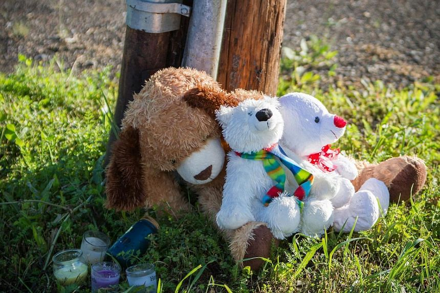 A memorial sits outside the Reptile Ocean exotic pet store in Campbellton, New Brunswick, Canada, on Tuesday, Aug 6, 2013. The owner of a python which is thought to have crushed two children to death in a Canadian apartment did not have a permit to k