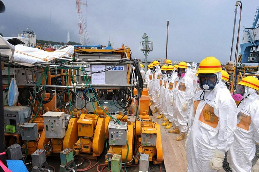 This photo taken on Aug 6, 2013 shows local government officials and nuclear experts inspecting a facility to prevent seeping of contamination water into the sea at Tokyo Electric Power's (Tepco) Fukushima Dai-ichi nuclear plant in Okuma, Fukushima p