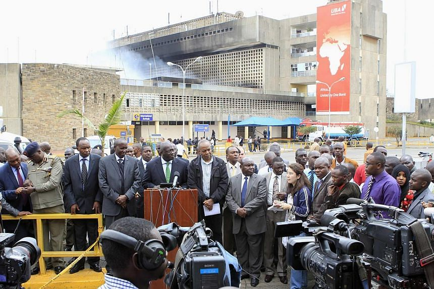 Kenya Airways and government officials address a joint news conference after a huge fire left all flights suspended at the Jomo Kenyatta International Airport, in Kenya's capital Nairobi on Aug 7, 2013.-- PHOTO: REUTERS
