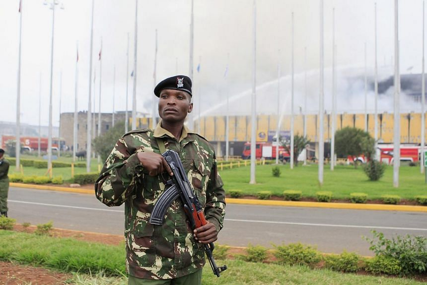 A uniformed police officer keeps guard after a huge fire left all flights suspended at the Jomo Kenyatta International Airport, in Kenya's capital Nairobi on Aug 7, 2013. -- PHOTO: REUTERS