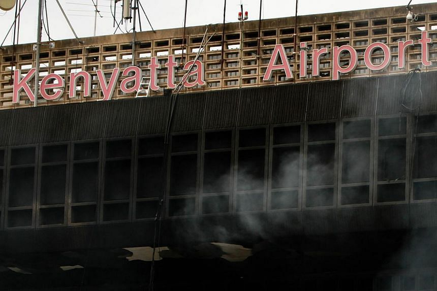 The burnt exterior of the Jomo Kenyatta international airport is pictured in Nairobi on Aug 7, 2013.-- PHOTO: AFP