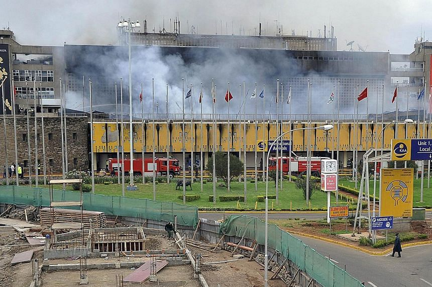 Smoke rises from the Jomo Kenya International Airport in Nairobi on Aug 7, 2013 as a massive fire shut down the country's main airport with flights diverted to regional cities and firefighters battled to put out the blaze in east Africa's biggest tra