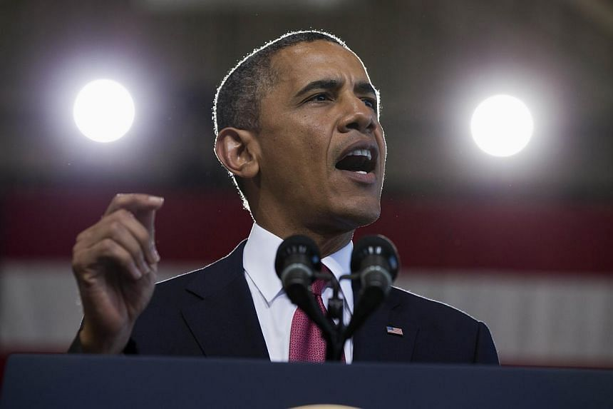 """President Barack Obama speaks to with US troops and their families at Marine Corps Base Camp Pendleton, Calif., on Wednesday, Aug 7, 2013.US President Barack Obama will mark the 50th anniversary of Martin Luther King's """"I have a dream"""" speech b"""