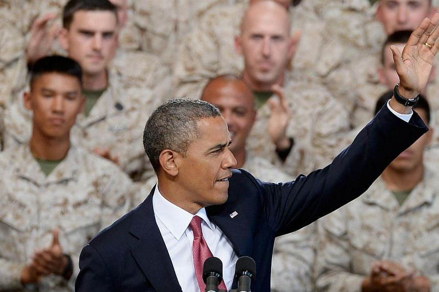 US President Barack Obama delivers remarks during his visit at Camp Pendleton Marine Corps base with troops and their families to thank them for their service on Aug 7, 2013 in Camp Pendleton, California. President Barack Obama insisted on Wedne