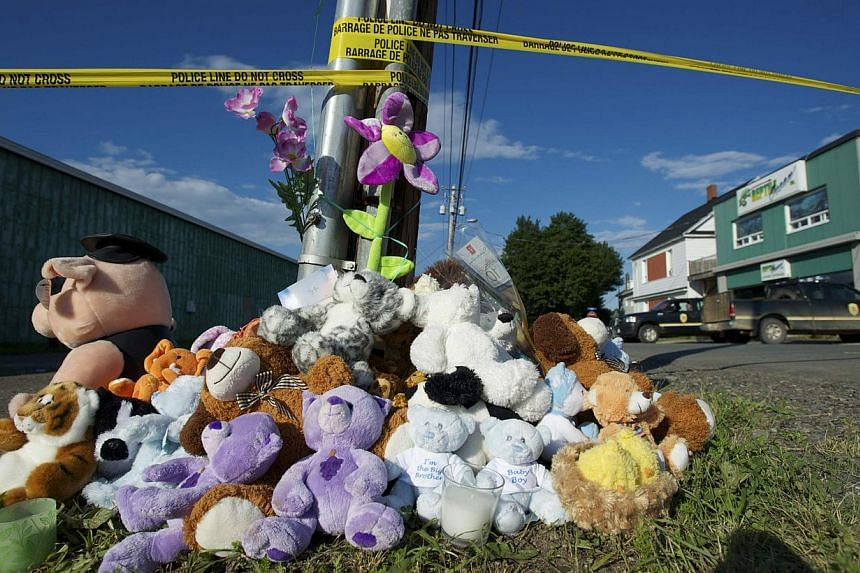 Stuffed animals are placed at a makeshift memorial across from the Reptile Ocean store on the evening of a vigil for Noah and Connor Barthe in Campbellton, New Brunswick on Aug 7, 2013. -- PHOTO: REUTERS