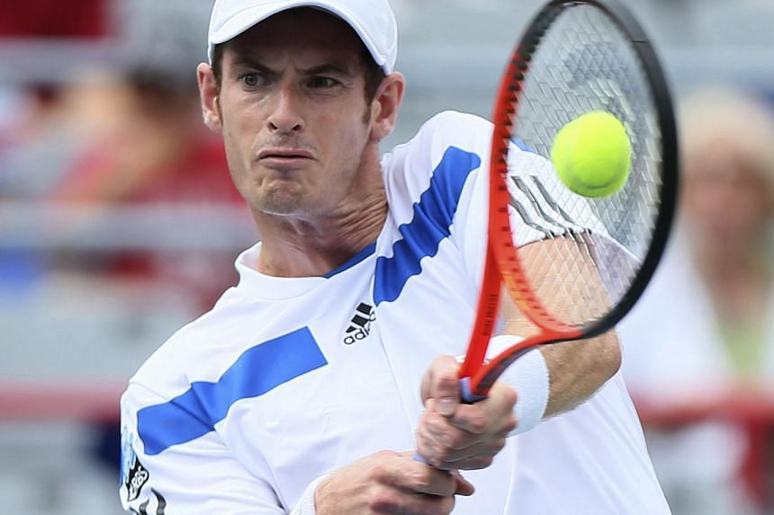 Andy Murray of Britain hits a return to Marcel Granollers of Spain at the Rogers Cup tennis tournament in Montreal Aug 7, 2013. Wimbledon champion Andy Murray and Rafael Nadal stepped on to a hard court for the first time in five months on Wednesday,